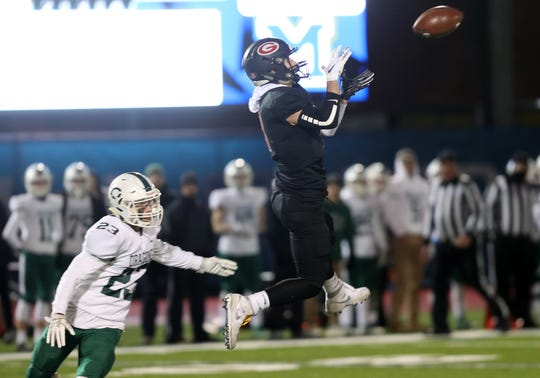 Rye's Matthew Tepedino (1) catches a pass in front of Cornwall's Jack Diamond (23) during the NYSPHSAA Class A state semifinal at Middletown High School Nov. 22, 2019.