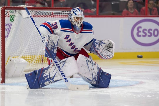 Nov 22, 2019; Ottawa, Ontario, CAN; New York Rangers goalie Henrik Lundqvist (30) lines up for a shot on goal in the second period against the Ottawa Senators at the Canadian Tire Centre. Mandatory Credit: Marc DesRosiers-USA TODAY Sports