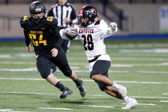Wichita Falls High's Julian Carrillo (28) runs the ball against El Paso ParklandÕs Gabe Chavez in the Region I-5A Division II area-round playoff game November 22, 2019 at Grande Communications Stadium in Midland. Photo credit : James Durbin