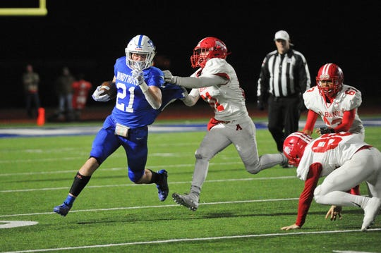Awtry Blagg rushes the ball for Windthorst as the Trojans defeat the Albany Lions 24-20.