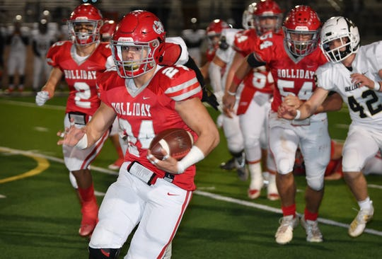 Holliday runningback Tristin Boyd picks up good yardage on this carry against the Palmer Bulldogs Friday night in Mineral Wells.