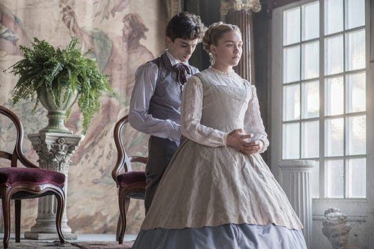 """Amy March (Florence Pugh) gets a hand from childhood friend Laurie (Timothee Chalamet) in """"Little Women."""""""