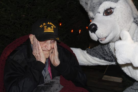 Howard Lloyd gets a thumbs-up from Matawan High School's Husky mascot