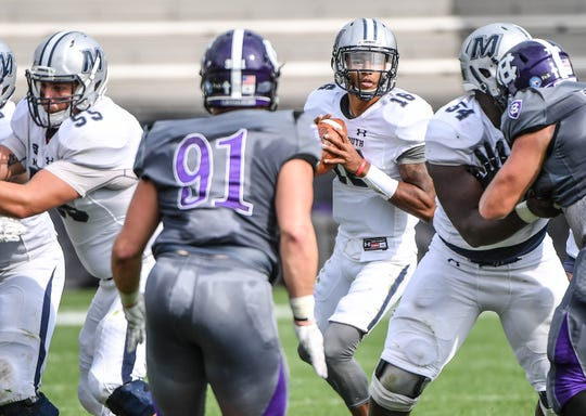 Monmouth quarterback Kenji Bahar looks downfield against Holy Cross in the Hawks' 48-36 win in 2017. The two teams play on Saturday in West Long Branch in the opening round of the FCS Playoffs.