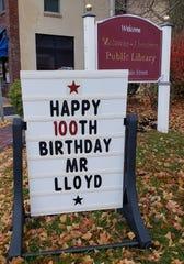 A sign outside the Matawan-Aberdeen Public Library wishes Howard Lloyd a happy 100th birthday.