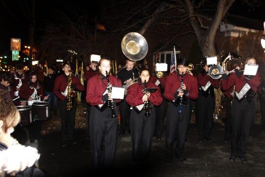 "The Matawan High School marching band serenades Howard Lloyd with ""Happy Birthday"" on his 100th birthday."