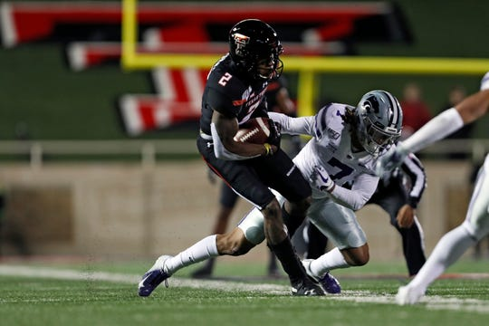 Kansas State's Kevion McGee (7) tackles Texas Tech's RJ Turner (2) during the first half of an NCAA college football game Saturday, Nov. 23, 2019, in Lubbock, Texas. (Brad Tollefson/Lubbock Avalanche-Journal via AP)