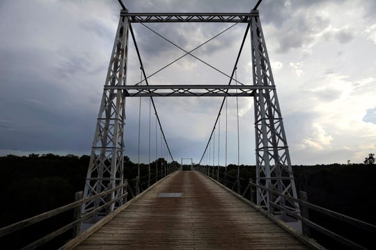 The Regency Bridge over the Colorado River connecting Mills and San Saba counties, in May 2013. Originally built in 1939, the bridge is reported to be the only one in Texas still allowing automobiles to cross it