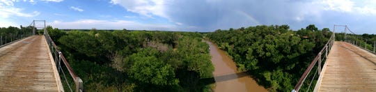 A 180-degree panoramic photograph of the Regency Suspension Bridge looking east in May 2013.