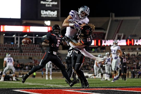 Texas Tech's Thomas Leggett (16) tackles Kansas State's Dalton Schoen (83) who misses a pass during the first half of an NCAA college football game Saturday, Nov. 23, 2019, in Lubbock, Texas. (Brad Tollefson/Lubbock Avalanche-Journal via AP)