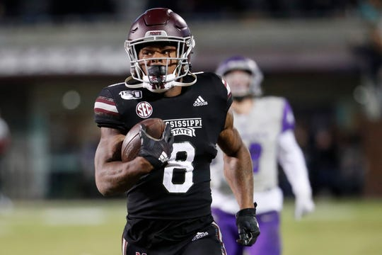 Mississippi State running back Kylin Hill (8) runs past Abilene Christian players on his way to an 88-yard touchdown reception during the first half Saturday, Nov. 23, 2019, in Starkville, Miss.