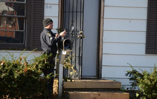 Police were at the scene of a fatal shooting through the night and continued searching for evidence on Sunday.