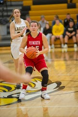 Plymouth's Mackenzie Back looks to make a pass as Colonel Crawford's Hannah Plesac closes in.