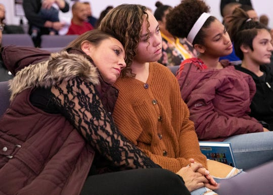 Jamie Sherman lays her head on her daughter Tiana Wingo's shoulder and holds her hand during a sermon at Zion Baptist Church on Nov. 24, 2019. One of the first steps to her recovery was to forgive herself and build the relationship back up with her 13-year-old daughter Tiana.