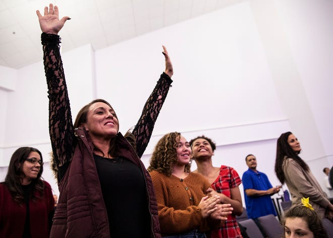 Jamie Sherman, a Chillicothe native, praises the Lord as she attends church at Zion Baptist on Sunday, Nov. 24, 2019.