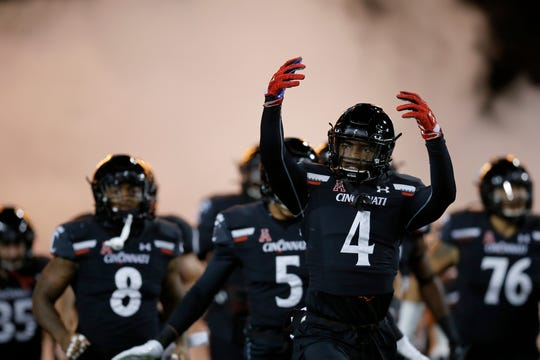 The Cincinnati Bearcats take the field before the first quarter of the NCAA American Athletic Conference game between the Cincinnati Bearcats and the Temple Owls at Nippert Stadium in Cincinnati on Saturday, Nov. 23, 2019.