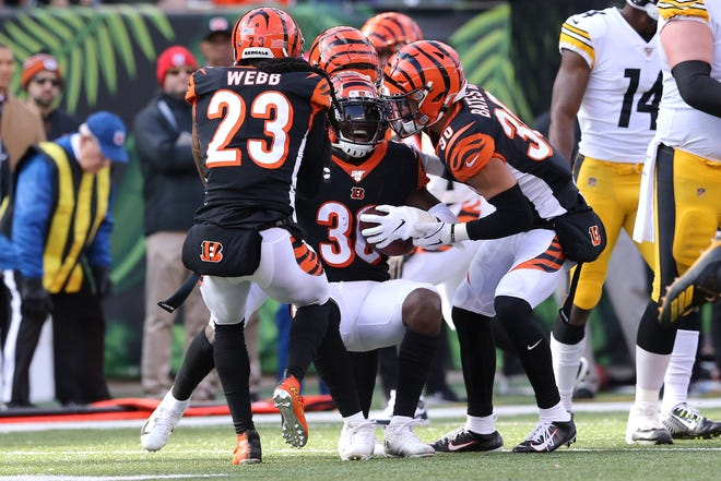 Cincinnati Bengals strong safety Shawn Williams (36) is helped up after intercepting a pass in the first quarter of an NFL Week 12 game against the Pittsburgh Steelers, Sunday, Nov. 24, 2019, at Paul Brown Stadium in Cincinnati.