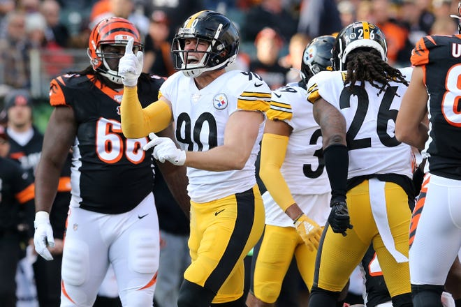 Pittsburgh Steelers outside linebacker T.J. Watt (90) reacts after tackling Cincinnati Bengals running back Giovani Bernard (25) in the first quarter of an NFL Week 12 game, Sunday, Nov. 24, 2019, at Paul Brown Stadium in Cincinnati.