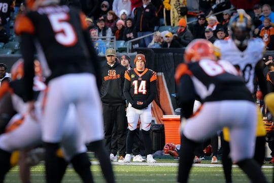 Cincinnati Bengals quarterback Andy Dalton (14) watches the offense in the fourth quarter of an NFL Week 12 game, Sunday, Nov. 24, 2019, at Paul Brown Stadium in Cincinnati. The Pittsburgh Steelers won 16-10, and the Cincinnati Bengals fell to 0-11 on the season.