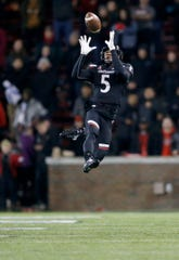 Cincinnati Bearcats safety Darrick Forrest (5) leaps to intercept a pass and seal the game for UC in the fourth quarter of the NCAA American Athletic Conference game between the Cincinnati Bearcats and the Temple Owls at Nippert Stadium in Cincinnati on Saturday, Nov. 23, 2019. The Bearcats clinched the AAC East championship with a 15-13 win over Temple.