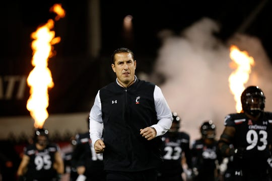 Cincinnati Bearcats head coach Luke Fickell leads his team onto the field for the first quarter of the NCAA American Athletic Conference game between the Cincinnati Bearcats and the Temple Owls at Nippert Stadium in Cincinnati on Saturday, Nov. 23, 2019.