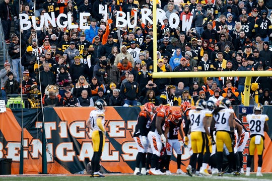 "Fans raise a sign ""Bungle 4 Burrow"" in the fourth quarter of the NFL Week 12 game between the Cincinnati Bengals and the Pittsburgh Steelers at Paul Brown Stadium in downtown Cincinnati on Sunday, Nov. 24, 2019. The Steelers dealt the Bengals loss No. 11, 16-10, at home."