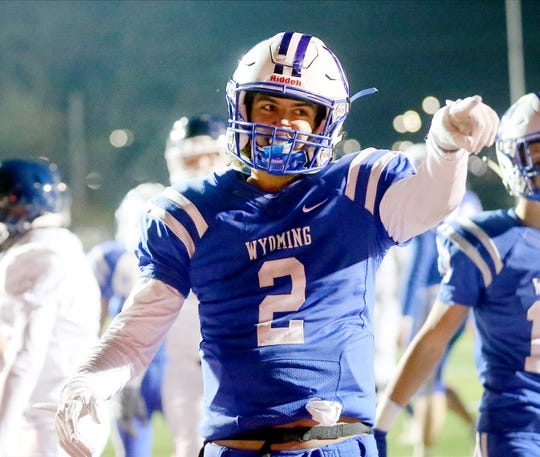 Wyoming QB Evan Prater reacts after scoring a touchdown during the Cowboys playoff game against Valley View, Saturday, Nov. 23, 2019.