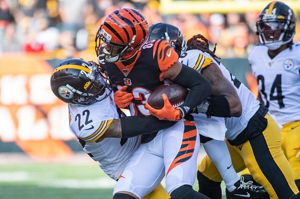 Tyler Boyd #83 of the Cincinnati Bengals is tackled after making a first down catch during the first quarter of the game against the Pittsburgh Steelers at Paul Brown Stadium on November 24, 2019 in Cincinnati, Ohio.