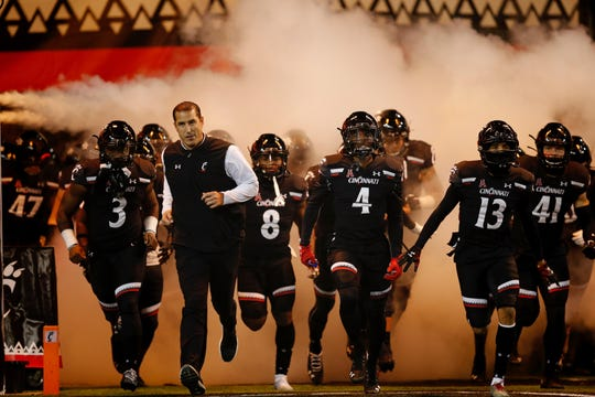 Luke Fickell takes the Nippert Stadium field with his Bearcats prior to hosting Temple University.