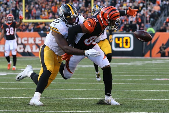 Cincinnati Bengals wide receiver Tyler Boyd (83) fumbles as Pittsburgh Steelers linebacker Devin Bush (55) defends in the fourth quarter of an NFL Week 12 game, Sunday, Nov. 24, 2019, at Paul Brown Stadium in Cincinnati. The Pittsburgh Steelers won 16-10, and the Cincinnati Bengals fell to 0-11 on the season.
