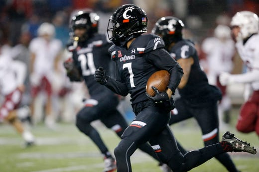 Cincinnati Bearcats cornerback Coby Bryant (7) returns a blocked point after attempt 98 yards for a 2-point touchdown in the fourth quarter of the NCAA American Athletic Conference game between the Cincinnati Bearcats and the Temple Owls at Nippert Stadium in Cincinnati on Saturday, Nov. 23, 2019. The Bearcats clinched the AAC East championship with a 15-13 win over Temple.