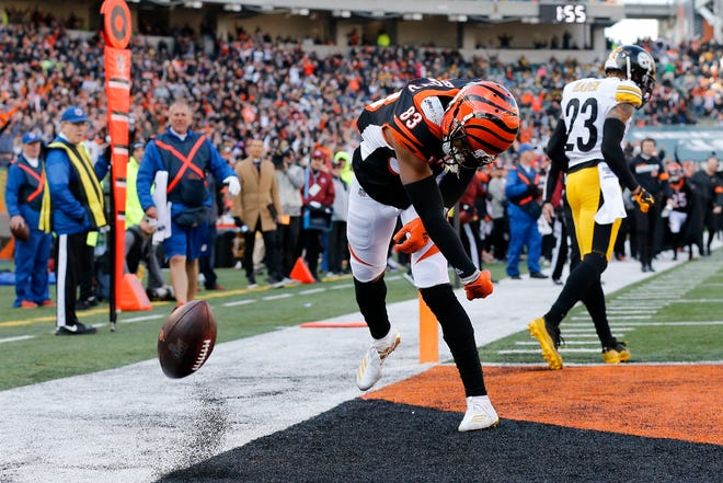 Cincinnati Bengals wide receiver Tyler Boyd (83) spikes the ball after a touchdown reception in the second quarter of the NFL Week 12 game between the Cincinnati Bengals and the Pittsburgh Steelers at Paul Brown Stadium in downtown Cincinnati on Sunday, Nov. 24, 2019. The Bengals led 7-3 at halftime.
