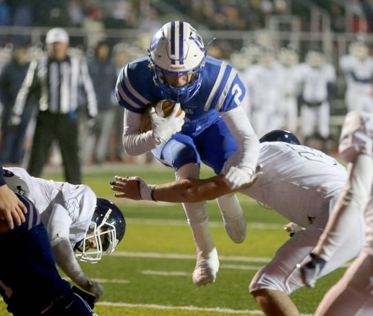 Wyoming Qb Evan Prater scores one of his 5 touchdowns during the Cowboys playoff win over Valley View, Saturday, Nov. 23, 2019.