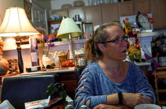 Dora Podkovyroff speaks at her dining table during an interview at the Podkovyroff residence in Clarksville, Tenn., on Friday, Nov. 15, 2019.