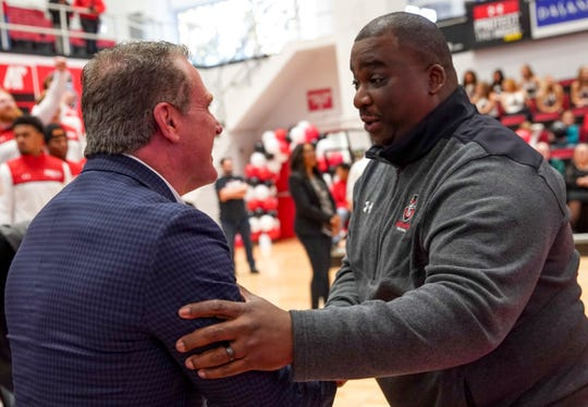 Head coach Mark Hudspeth and athletic director Gerald Harrison celebrate after the reveal of the Governors' bracket placement at the FCS playoffs bracket announcement watch party at Winfield Dunn Center in Clarksville, Tenn., on Sunday, Nov. 24, 2019.