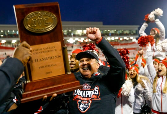 Austin Peay's head coach Mark Hudspeth celebrates with players and raises the OVC champions plaque at an Ohio Valley Conference game between the Austin Peay Governors and Eastern Illinois Panthers at Fortera Sadium in Clarksville, Tenn., on Saturday, Nov. 23, 2019.