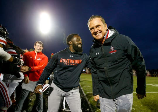 Austin Peay's head coach Mark Hudspeth reacts with a grin after being doused with a bucket of water on the sideline at an Ohio Valley Conference game between the Austin Peay Governors and Eastern Illinois Panthers at Fortera Sadium in Clarksville, Tenn., on Saturday, Nov. 23, 2019.