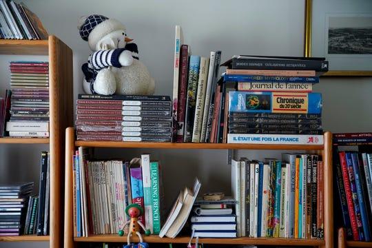 Books in many of Dora Podkovyroff's spoken languages rest on her shelves at the Podkovyroff residence in Clarksville, Tenn., on Friday, Nov. 15, 2019.