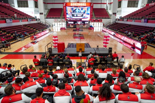 Austin Peay players sit in the Dunn Center stands and watch the start of the FCS selection show at a watch party Sunday.