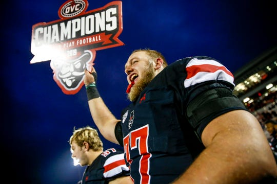 Austin Peay's offensive lineman Kyle Anderton (77) holds up a sign declaring APSu as OVC conference champions at an Ohio Valley Conference game between the Austin Peay Governors and Eastern Illinois Panthers at Fortera Sadium in Clarksville, Tenn., on Saturday, Nov. 23, 2019.