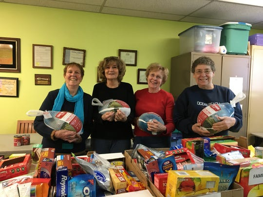 Each year Wegmans donates turkeys to needy families in Somerset County so they may enjoy a Thanksgiving meal. Members of the Bridgewater Senior Center provide all the non-perishables to fill the accompanying baskets. Here, Senior Affairs Coordinator Donna Langel, (second from left,) stands with volunteers Helen O'Neill, Jan Sopko, and Barbara Albani, holding a donated Wegmans turkey.