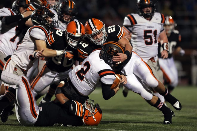 Ironton's Reid Carrico tackles Ridgewood's Gabe Tingle in the Division V regional finals last season at Nelsonville-York. Carrico and Tingle are back as the two teams will meet again tonight in Ironton.
