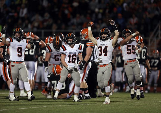 Ridgewood celebrates after Ironton get stopped on downs in the Division V regional finals at Nelsonville-York High School Saturday night.