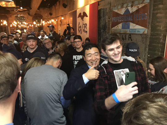 Democratic presidential candidate Andrew Yang takes a selfie with a supporter in Lincoln's Pub in Council Bluffs on Saturday, Nov. 23, 2019.
