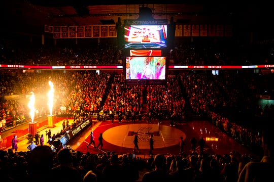 Fans fill Hilton Coliseum for the Iowa, Iowa State Cy-Hawk wrestling dual on Sunday, Nov. 17, 2019, in Hilton Coliseum.