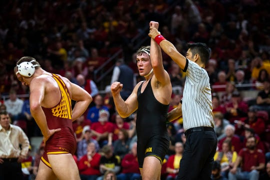 Iowa's Jacob Warner wins his match against Iowa State's Joel Shapiro at 197 during the Cy-Hawk dual on Sunday, Nov. 17, 2019, in Hilton Coliseum.