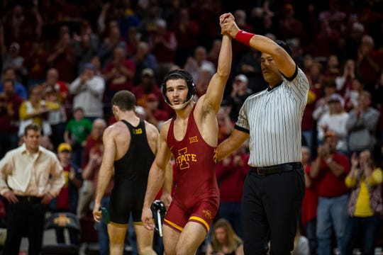 Iowa State's Ian Parker wins his match against Iowa's Carter Happel at 141 during the Cy-Hawk dual on Sunday, Nov. 17, 2019, in Hilton Coliseum.