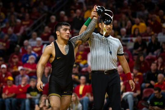 Pat Lugo won a Midlands title at 149 pounds on Monday night.