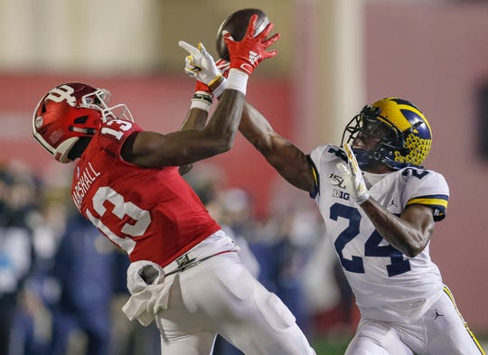 Indiana's Miles Marshall goes up to make the catch against Michigan's Lavert Hill during the second half Nov. 23, 2019 in Bloomington, Indiana.