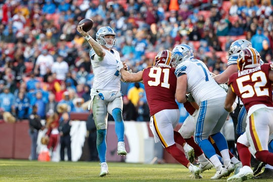 Jeff Driskel passes past Washington Redskins linebacker Ryan Kerrigan (91) as Detroit Lions tackle Rick Wagner (71) blocks during the second half at FedExField, Nov. 24, 2019.